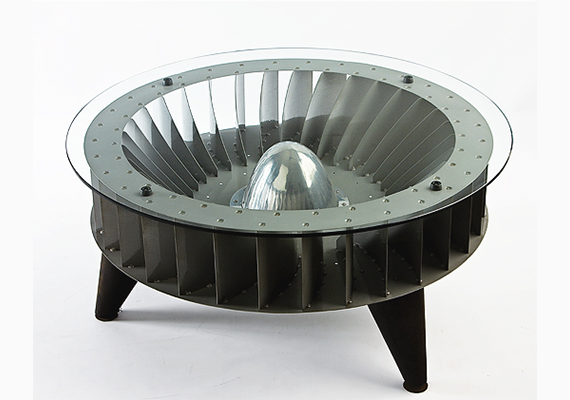 A lounge table built out of a turbine.